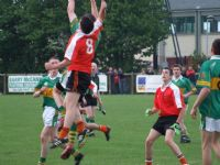 Paddy McAuley leaps and fields a high ball