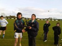 Ruairí receives his skills winner award from Leo Heatley