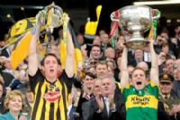Kilkenny captain Michael Fennelly raises the Mc Carthy Cup while Kerry Captain Darren O'Sullivan holds aloft the Sam Maguire